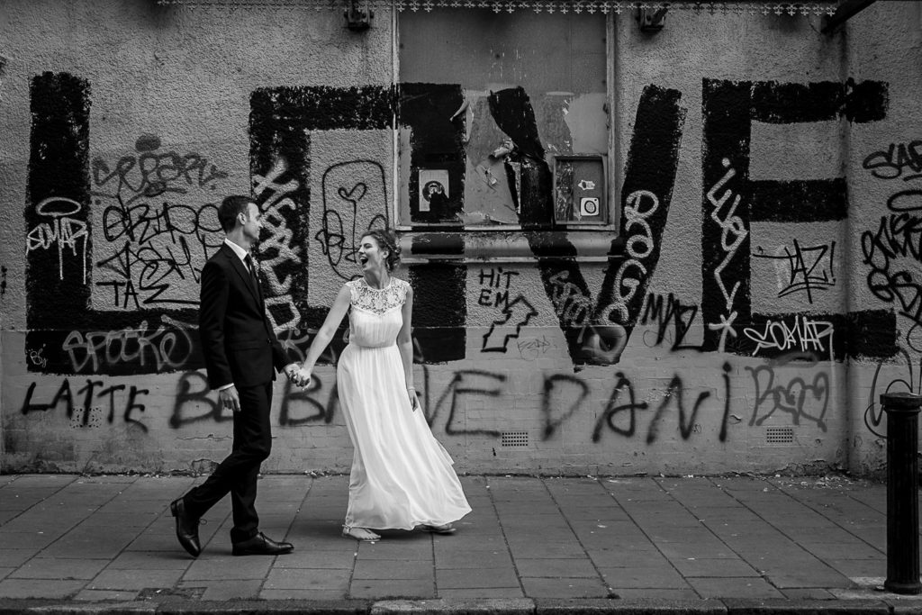 couple taking photos on graffiti streets in Brighton