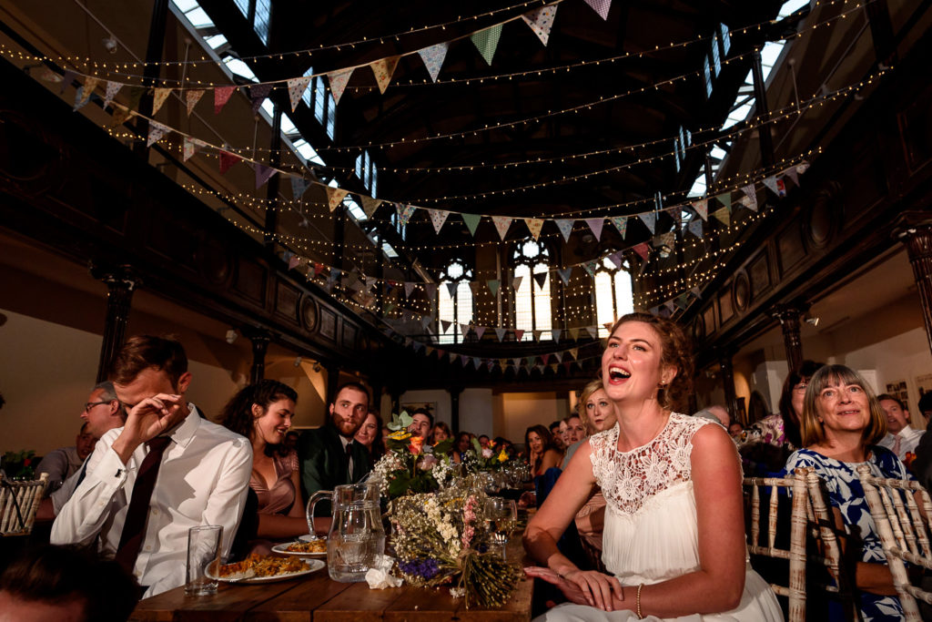 bride laughing during speeches at Fabrica Wedding venue