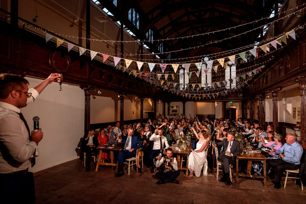 guests laughing during wedding speeches at Fabrica wedding venue