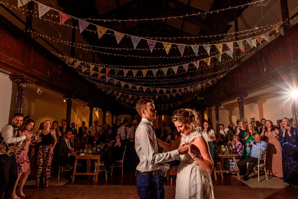 bride and groom enjoying first wedding dance at Fabrica wedding venue in Brighton