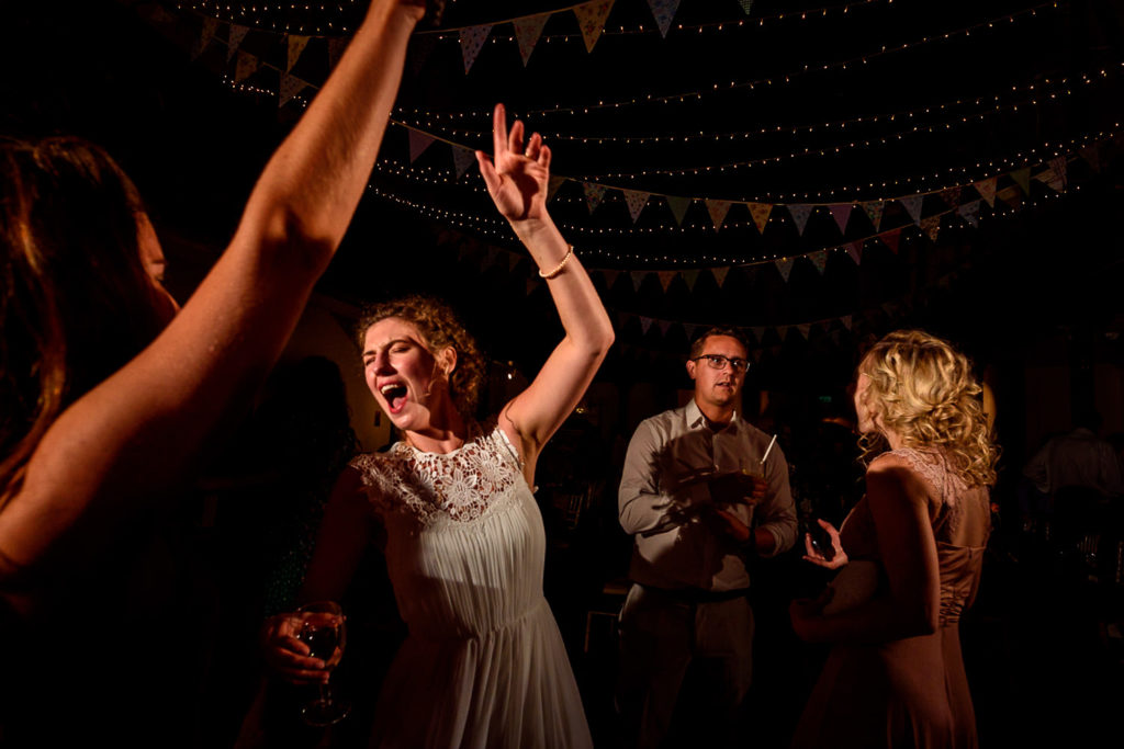 bride dancing at Fabrica wedding venue in Brighton