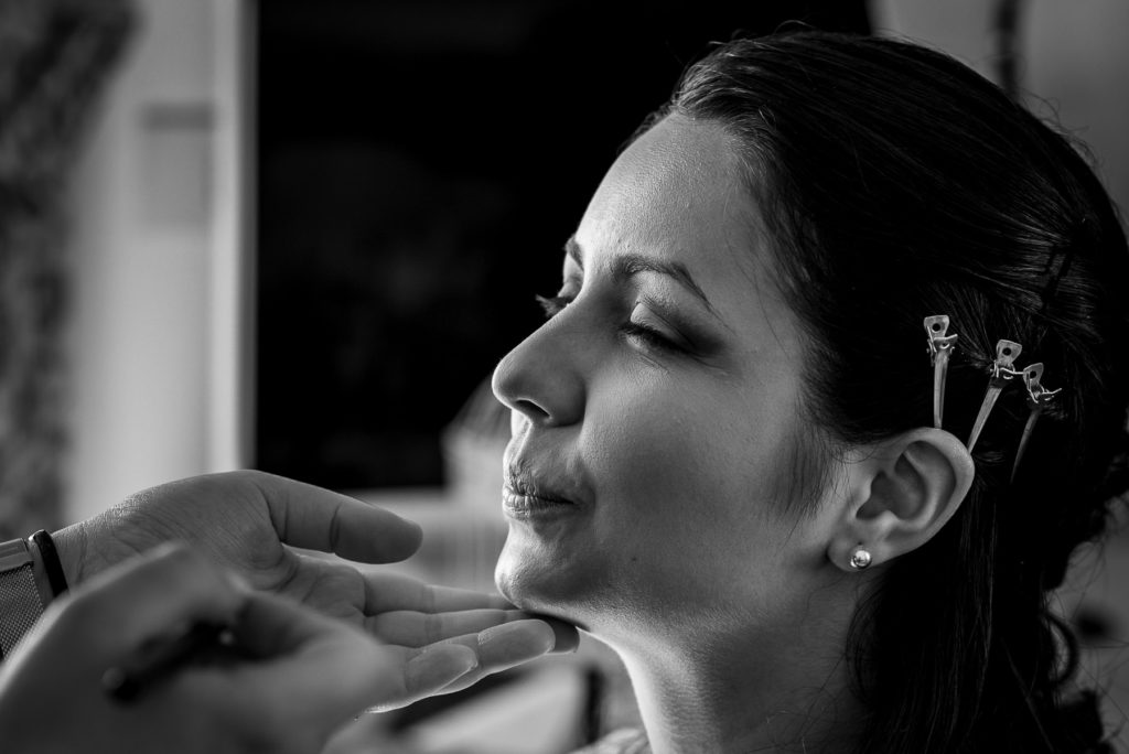 bride getting her makeup done on her wedding day in Italy