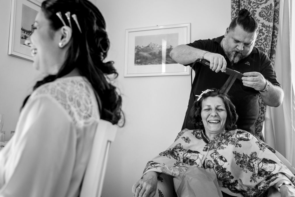 bride getting ready with her mum for her wedding