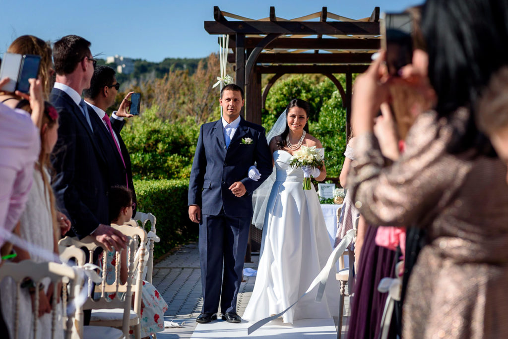 Bride walking down the aisle for her wedding ceremony at Villa Parisi Castiglioncello