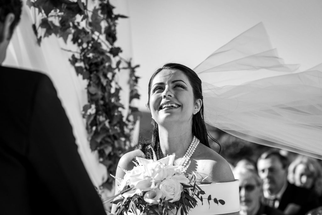 bride laughing during her destination wedding in Castiglioncello
