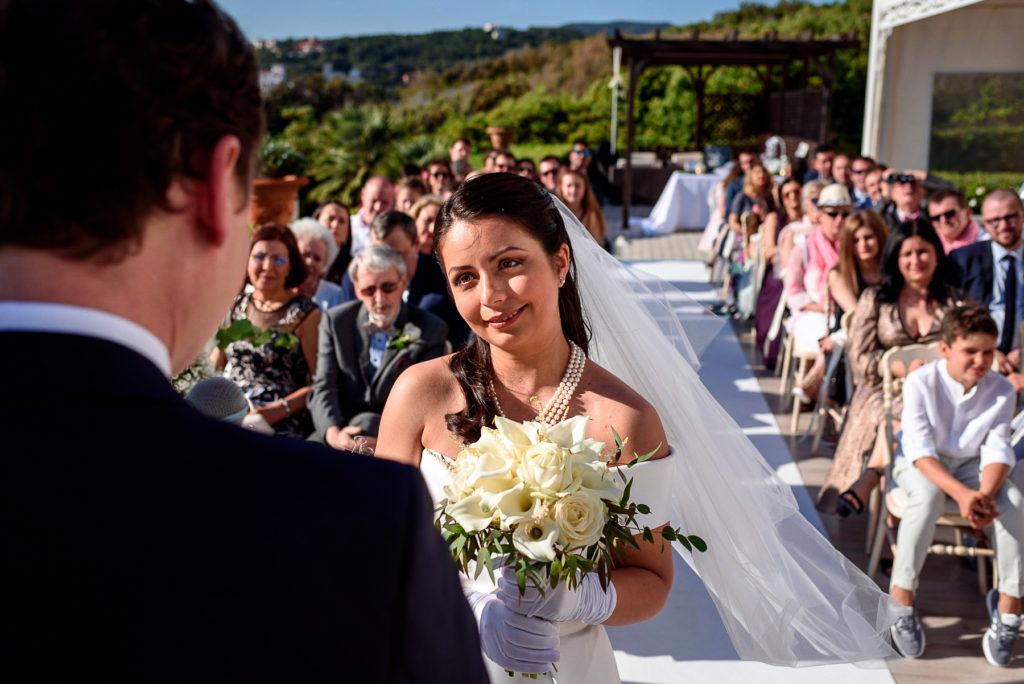 bride laughing during her wedding ceremony in Castiglioncello