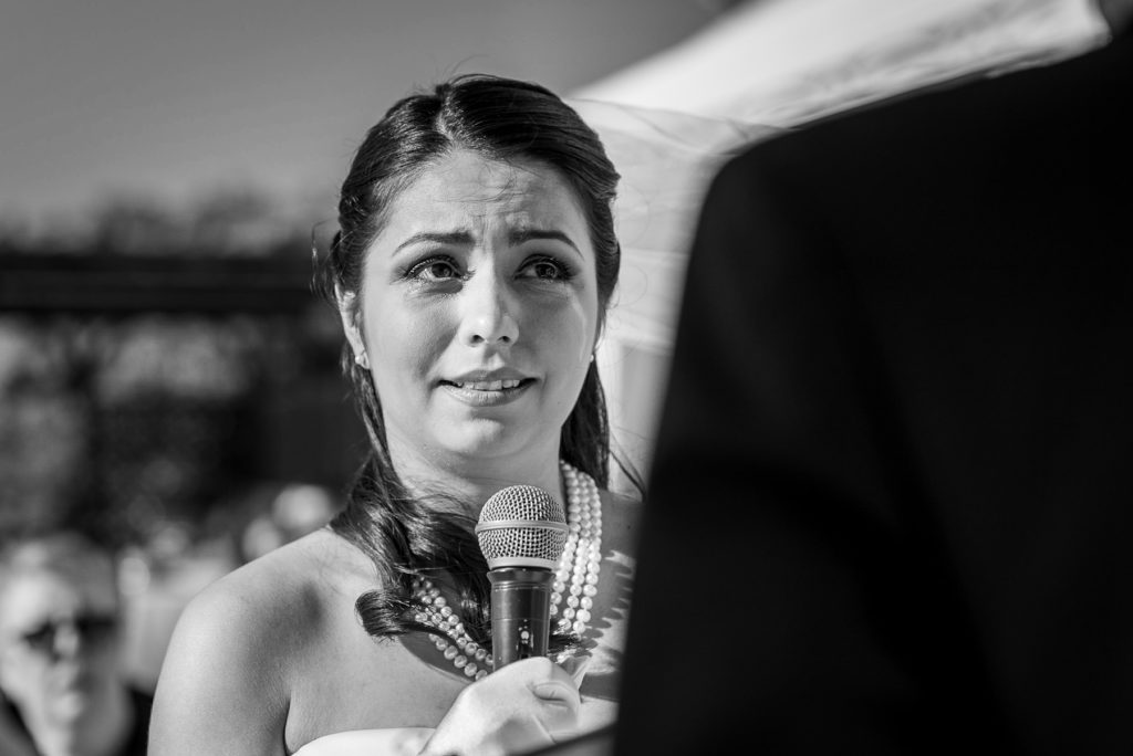 bride crying during wedding ceremony at Villa Parisi in Castiglioncello