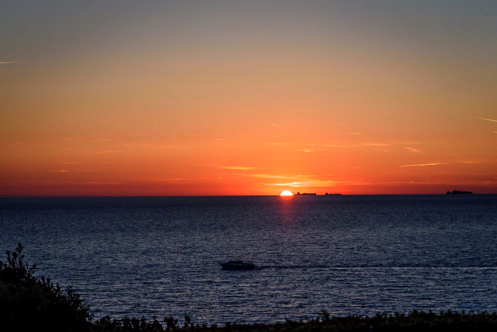 View of sunset over the sea from Villa Parisi