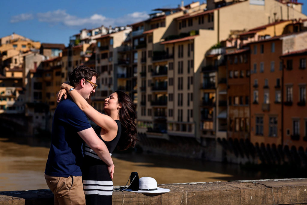 couple hugging in front of Ponte Vecchio Florence