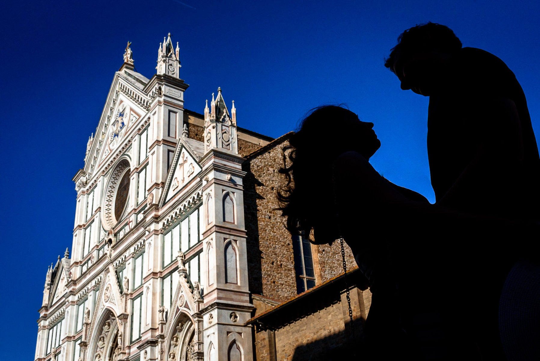 silhouette in front of Basilica di Santa Croce engagement photo