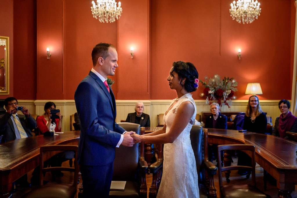 Bride and groom exchanging rings at Brighton town hall