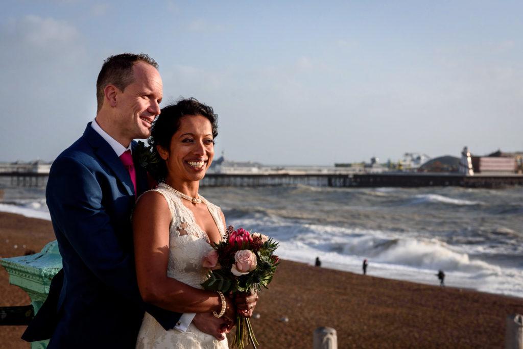 wedding couple posing with Brighton sea and Brighton Pavilion