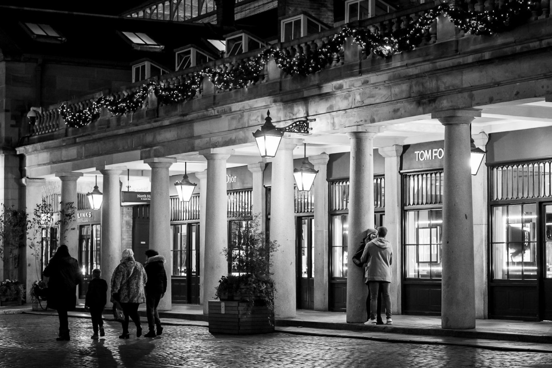 photographer capturing secret wedding proposal in Covent Garden London