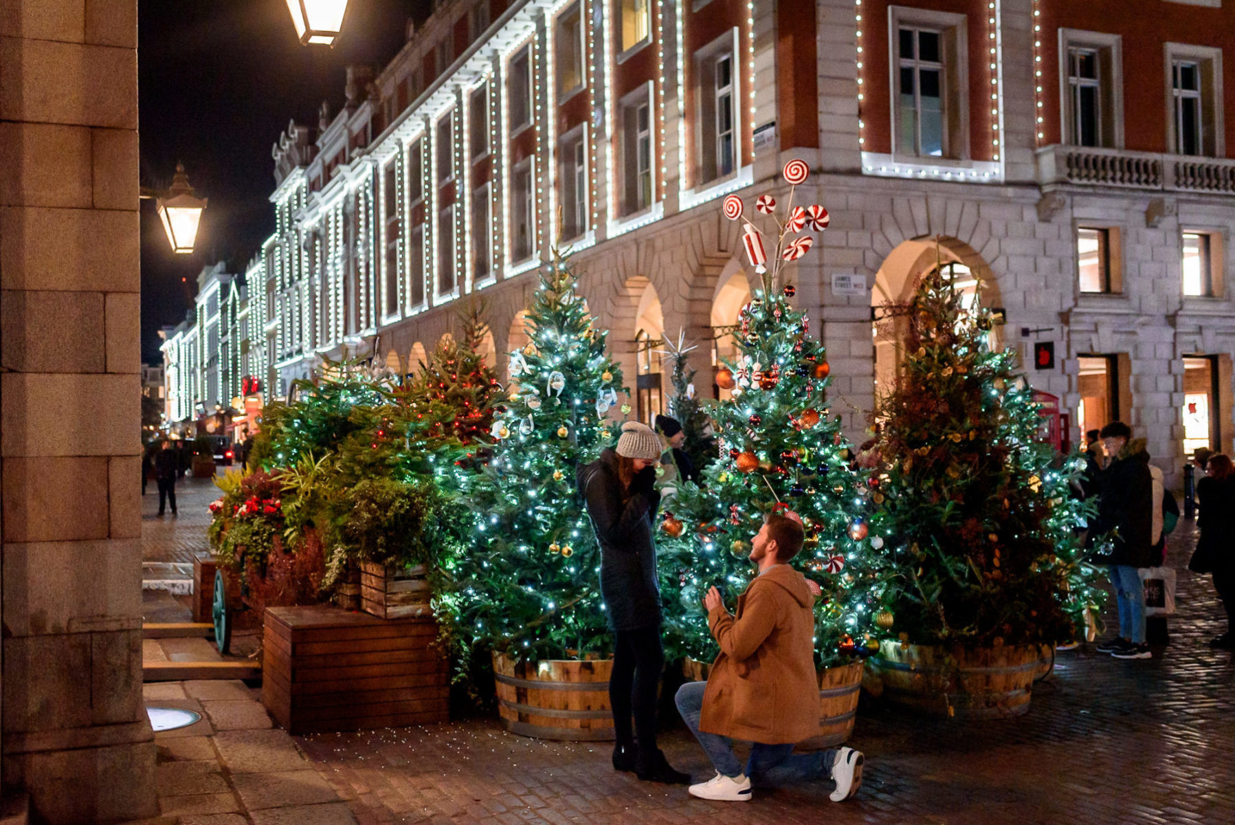 Secret proposal being photographed at Covent Garden in London