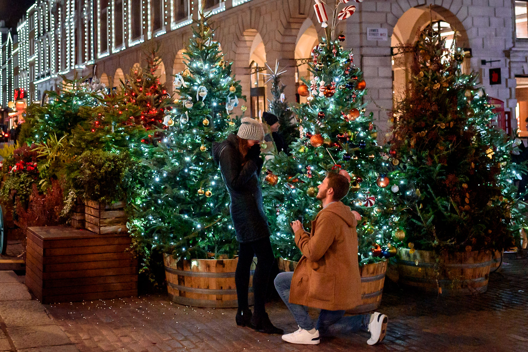 Proposing to his girlfriend at Covent Garden Christmas Market in London