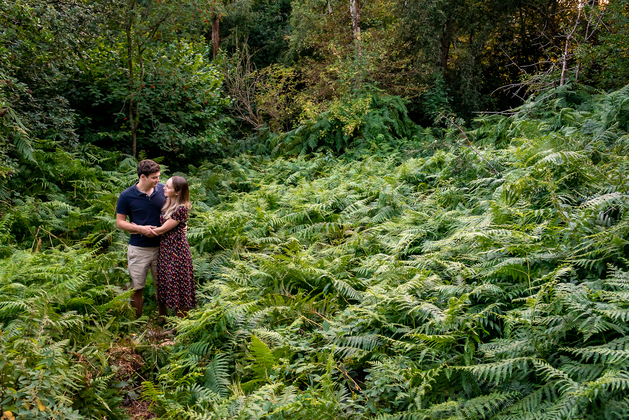 couple hugging in a field of ferns