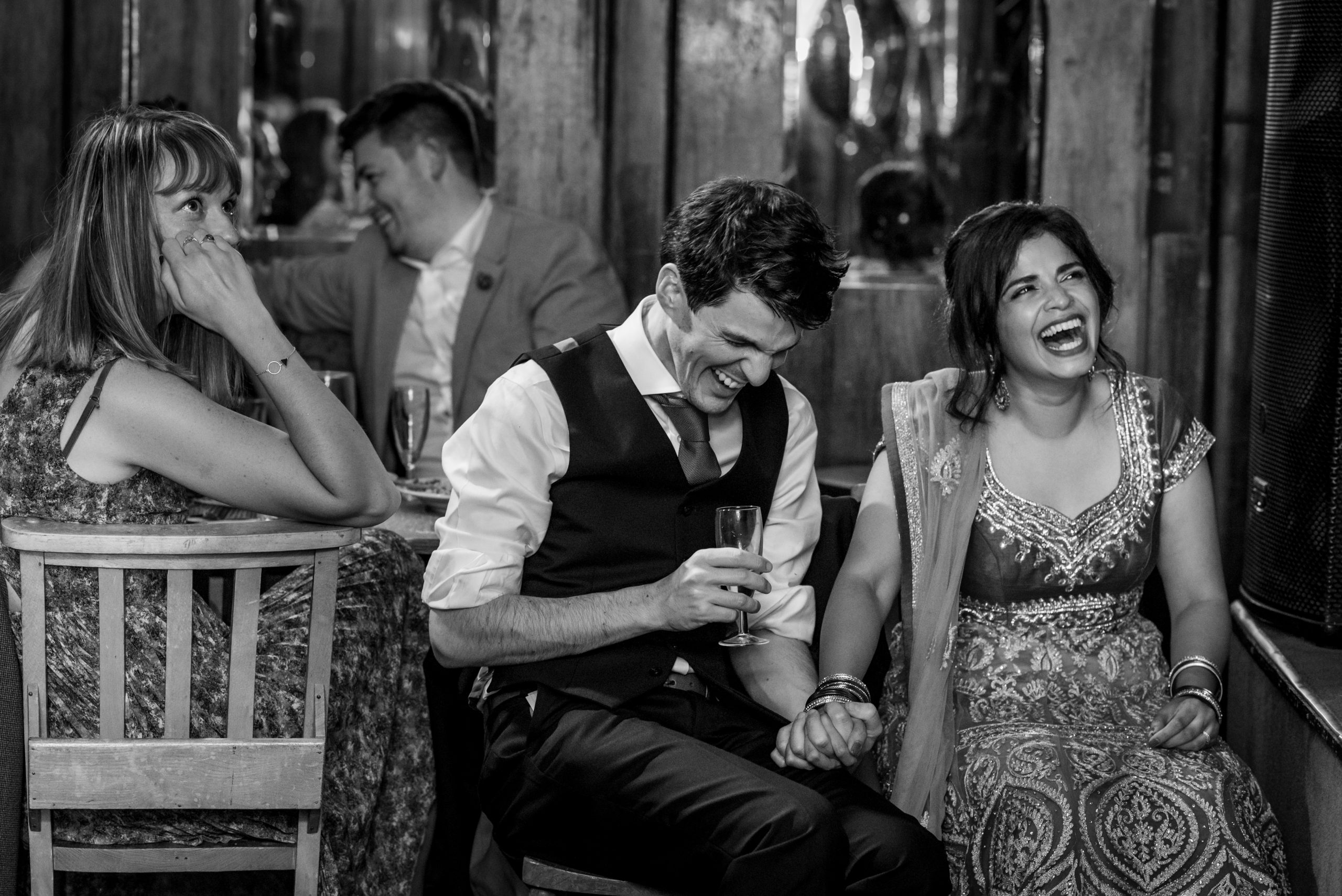 couple laughing during wedding speeches