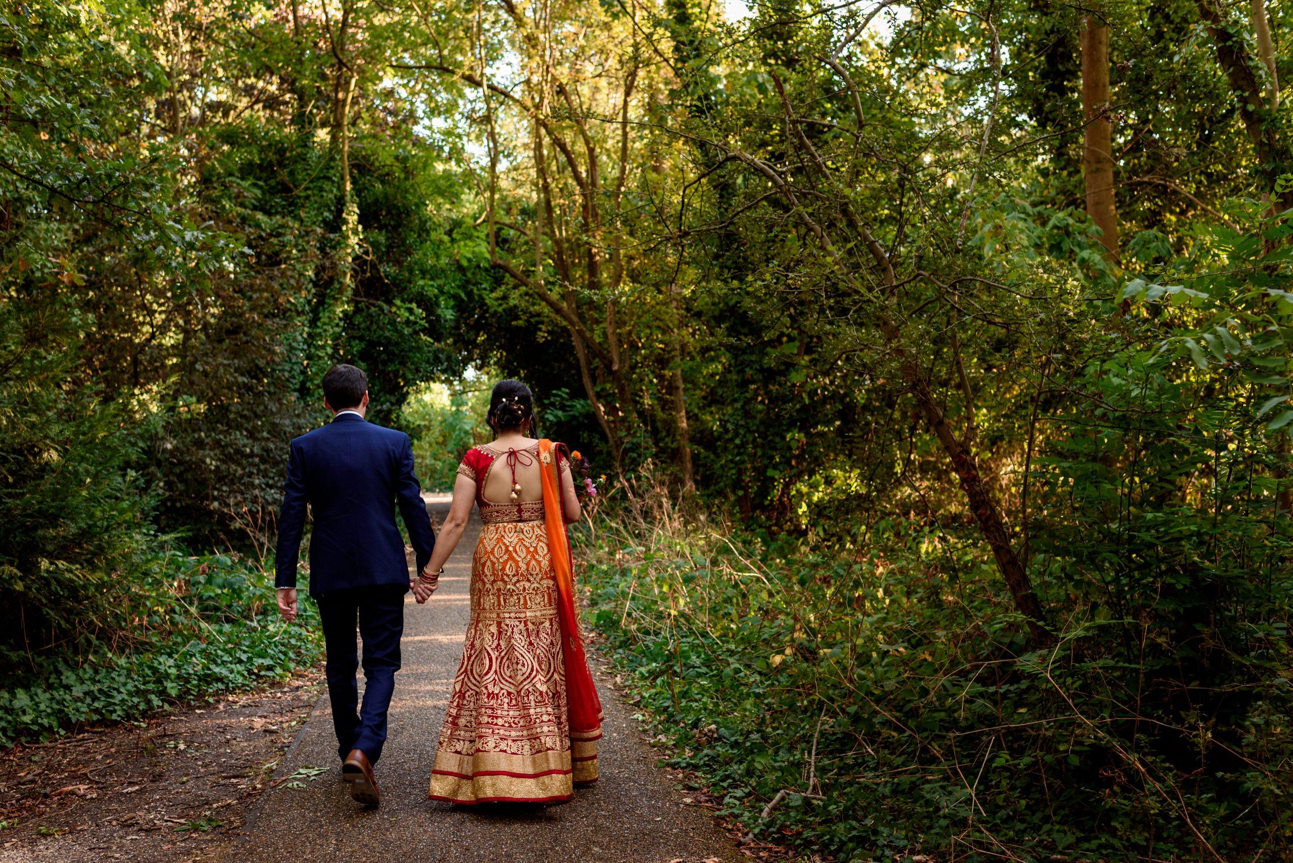 wedding couple walking in Peckham Rye park