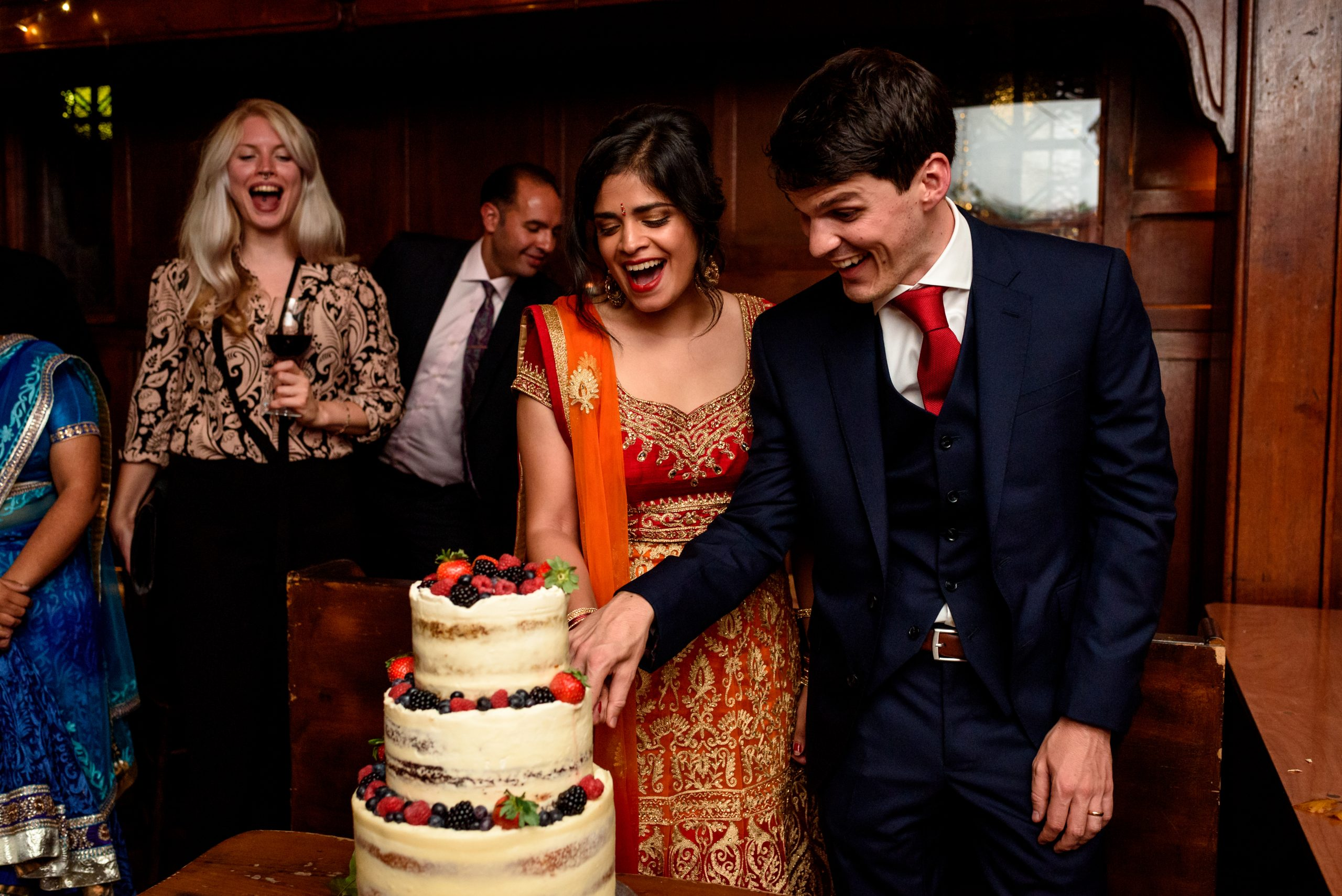 wedding couple cutting the cake at the Ivy House in Peckham