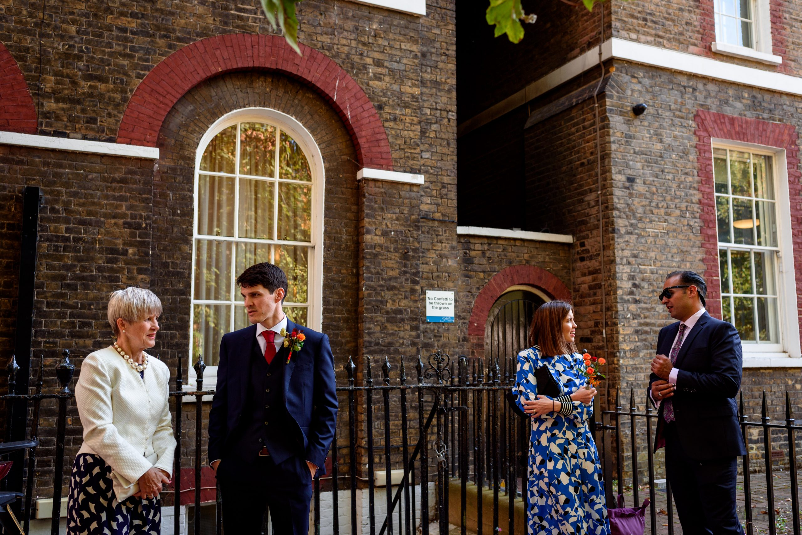 wedding guests waiting outside Southwark Registry office